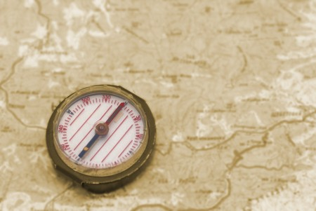 Compass over the topographic map- concept background photo