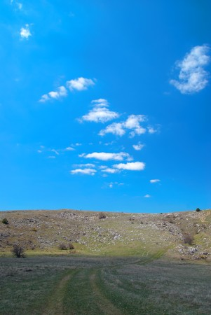 Hills with cloudscape and blue sky. Landscape. Stock Photo - 7227065