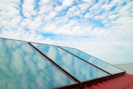 gelio: Solar system on the red house roof Stock Photo