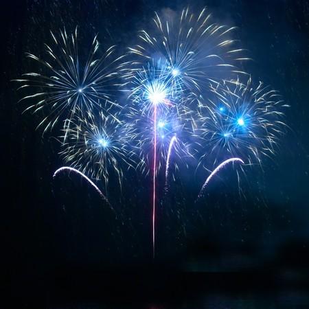 Blue fireworks on the black sky background Stock Photo - 7632998