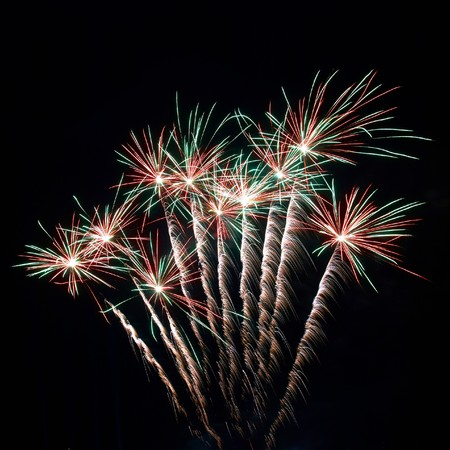 christmas in july: Colorful fireworks on the black sky background Stock Photo