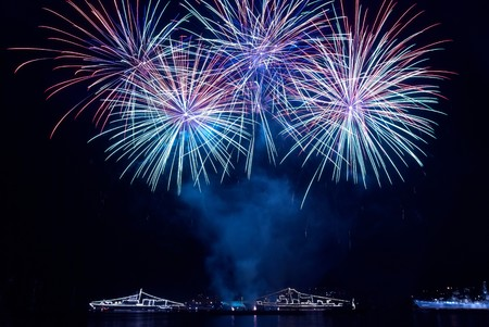 fireworks display: Colorful fireworks on the black sky background Stock Photo