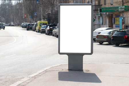 Vertical blank billboard on the city street photo