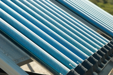 Vacuum solar water heating system on the house roof. Stock Photo - 7967090