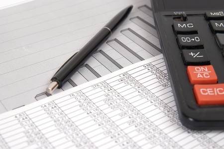 calculating: Pen and calculator on paper table with finance diagram Stock Photo
