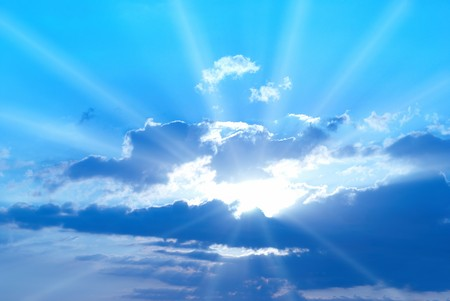 sun burst: Beautiful blue sky with sunbeams and clouds Stock Photo