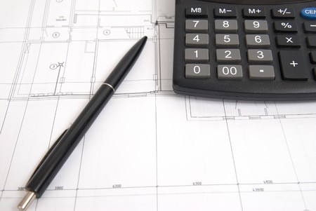 Working drawing with calculator and pen. Engineering equipment. photo