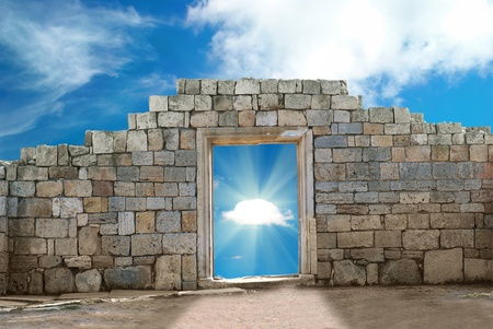 kingdom of heaven: Wall with entrance to the beautiful cloudscape Stock Photo