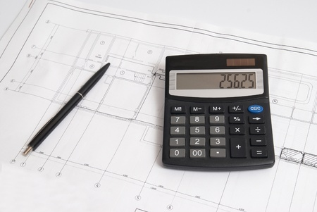 Working drawing with calculator and pen. Engineering equipment. Stock Photo - 8422194