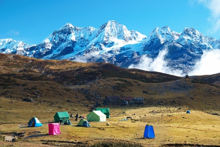 Top of High mountains, covered by snow. Kangchenjunga, India.