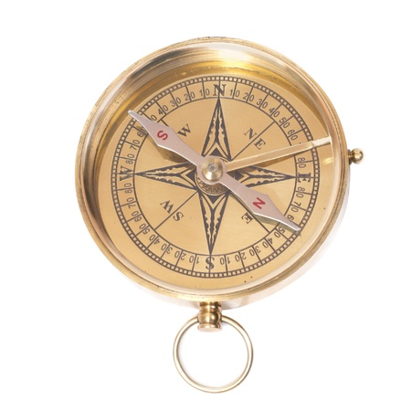 Golden ancient compass isolated on white background photo