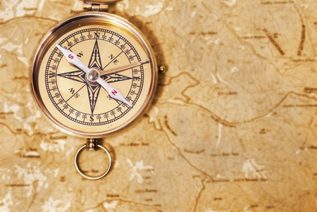 Ancient compass on the grunge old map  photo
