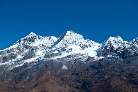Top of High mountains, covered by snow. Kangchenjunga, India. photo