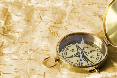 Ancient compass on the grunge old map Stock Photo - 8573165