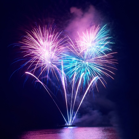 colorful light display: Colorful fireworks on the black sky background Stock Photo