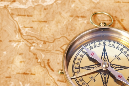 bygone: Ancient compass on the grunge old map