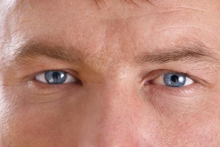 Young mans face. Close up macro portrait photo