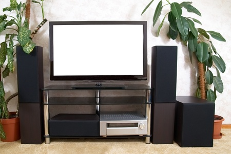 Home theater with empty white isolated screen photo