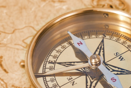 Ancient compass on the grunge old map Stock Photo - 9314327