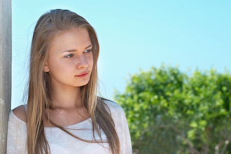 Beautiful blond girl outdoors against the sea Stock Photo - 10314291