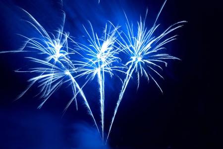 blu: Colorful fireworks on the black sky background Stock Photo