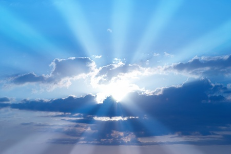 blue sky: Beautiful blue sky with sunbeams and clouds. Sun rays. Stock Photo