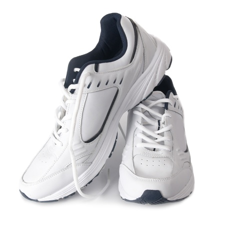 Pair white of trainers on isolated background photo
