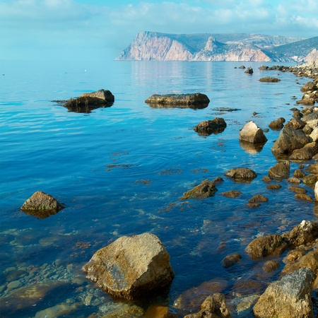Sea, shore and stones. Seascape at sunset. Stock Photo - 10582245