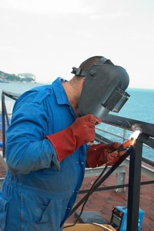 Welder at the factory working with metal construction Stock Photo - 11154140