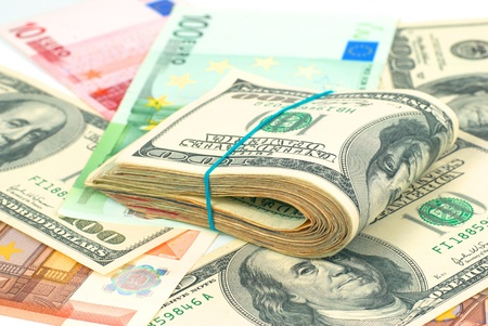Pile of money- cash of US dollars and euros for business background photo