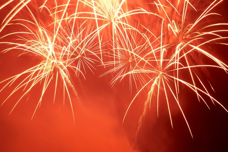 Red colorful fireworks on the black sky background. Holiday celebration. Stock Photo - 11599490