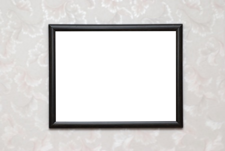 picture frame on wall: Empty blank black isolated photo frame on white wall Stock Photo