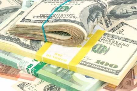 five dollars: Pile of money- cash of US dollars and euros for business background Stock Photo