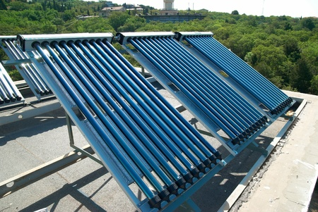 Vacuum solar water heating system on the house roof. Stock Photo - 12115512