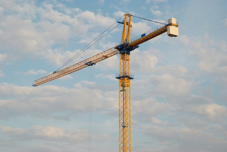 Building crane with the blue sky background photo