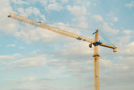 Building crane with blue sky background photo