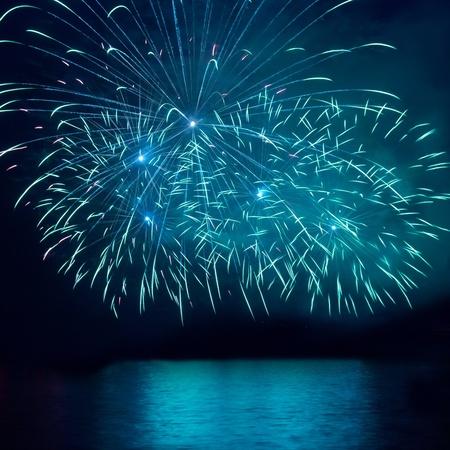 Blue fireworks on the black sky background Stock Photo - 12428520