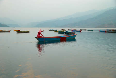 Wooden boats on the lake  Nepal evening  photo