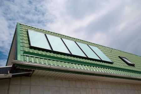 gelio: Solar water heating system on the roof  Stock Photo