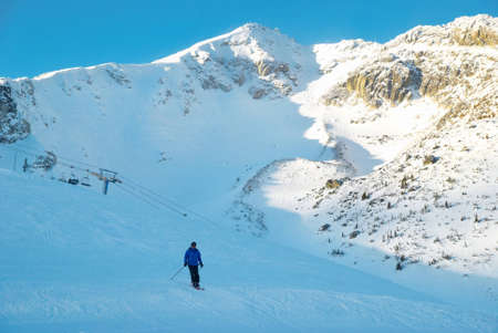 Skier on the mountain slope. Winter landscape. photo