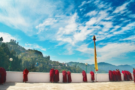 Monks in red robes in the indian monastery photo