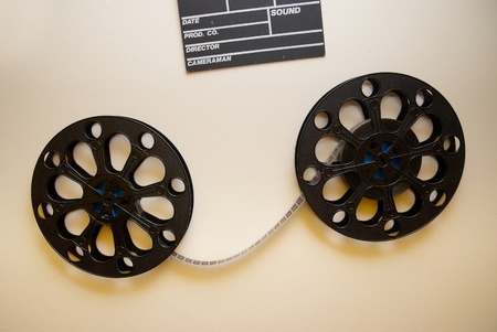 Two retro motion picture film reels with clapper board on the wall photo