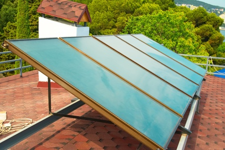 gelio: Solar water heating system on the red roof. Gelio panels. Stock Photo