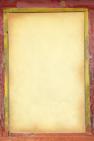 Yellow old paper in the old frame. Can be used for background Stock Photo - 13549538