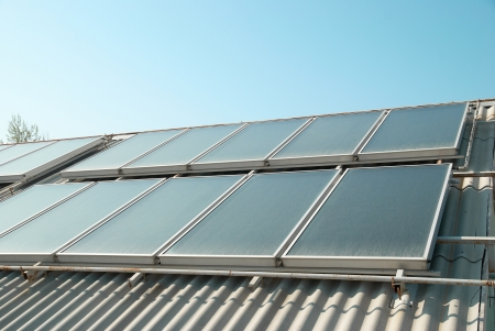 collector: Solar water heating system on the red roof  Gelio panels  Stock Photo