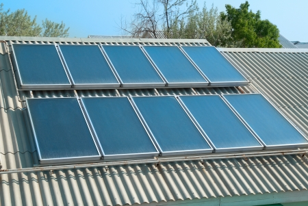 solar panel roof: Solar water heating system on the red roof  Gelio panels  Stock Photo
