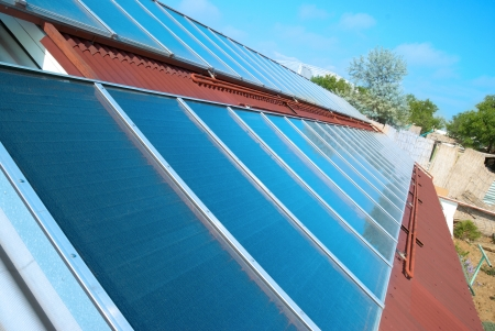 gelio: Solar water heating system on the red roof  Gelio panels  Stock Photo