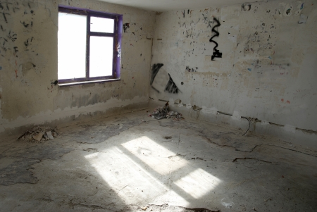 abandoned house window: Abandoned empty room with window and light from it