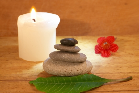Spa concept with candle zen stones and wooden background photo