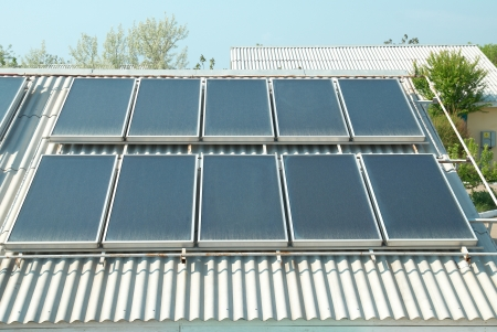 Solar water heating system on the red roof  Gelio panels  photo